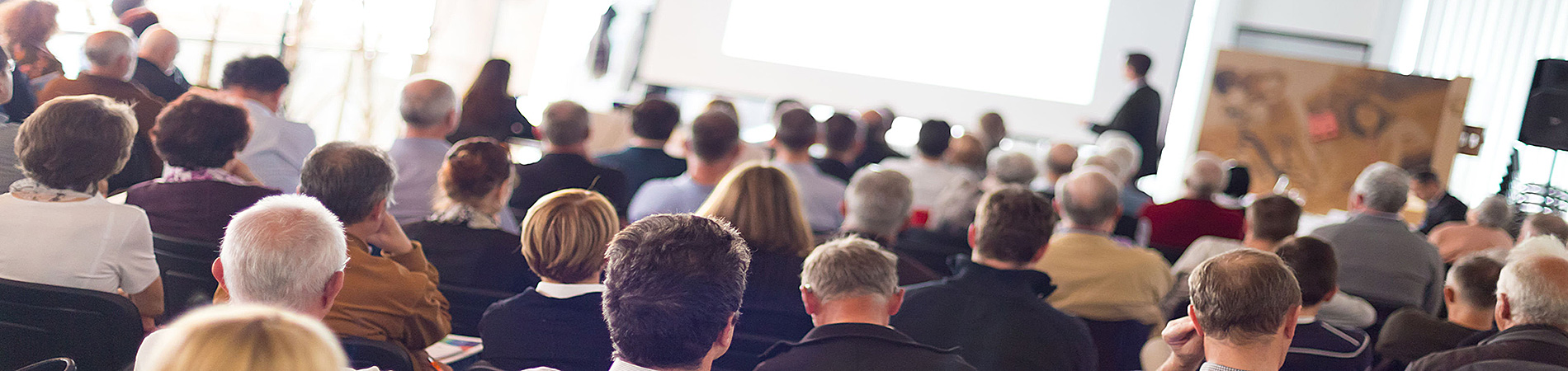 An audience attends a business event.